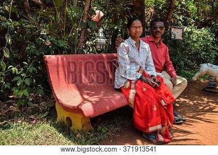 Kolhapur , Maharashtra / India- May 15th 2019; Picture Of Indian Couple Seating On Bench At Garden A