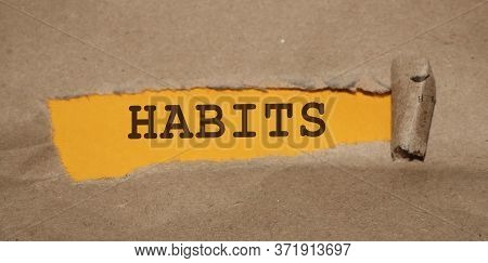 Habits Word Under Brown Torn Paper. Addiction Prevention Bad Habits Concept