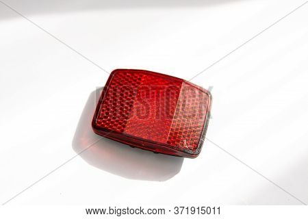A Red Dowels On A White Background