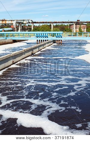 Water treatment tank with waste water in factory poster