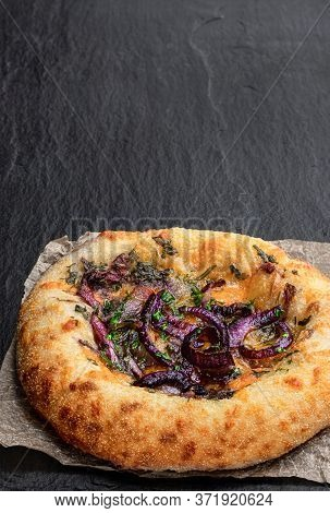 Red Cheddar  And Balsamic Red Onion Flatbread On Black Stone Background