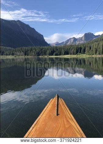 Canoe On Calm Lake, Lake With A Canoe, With Mountain Views