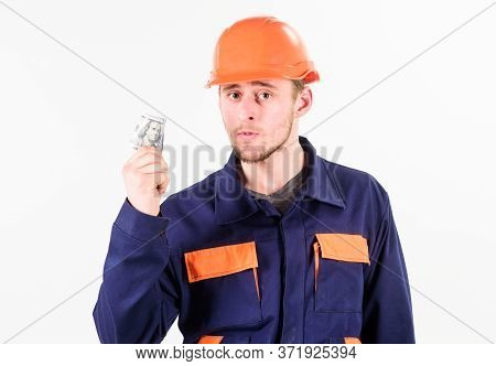 Builder Earn Money, Repairman Holds Cash, Rolled Banknotes In Hand.