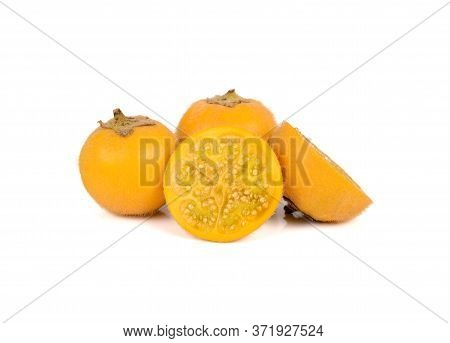 Whole And Half Cut Ripe Hairy-fruited Eggplant On White Background