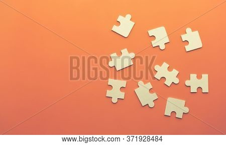 Conceptual Image Of Chaotically Lying Puzzles With A Place Under The Text On An Orange Background. O