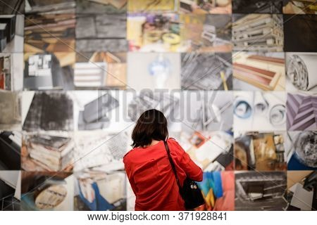 Bucharest, Romania - June 10, 2020: A Woman Is Looking At An Art Exhibit In The National Museum Of C