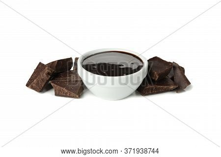 Melted Chocolate And Chocolate Pieces Isolated On White Background