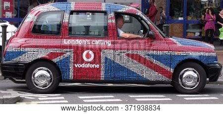 LONDON/UK- 30th July 2011: London taxi cab, decorated in the union jack.