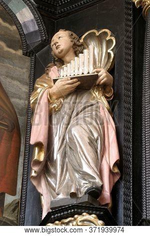 ZAGREB, CROATIA - MAY 16, 2013: Saint Cecilia, statue on the altar of Saint Apollonia in the Church of Saint Catherine of Alexandria in Zagreb, Croatia