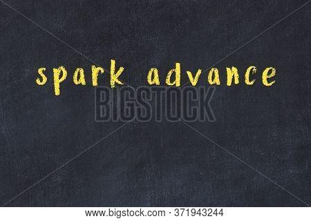 Chalk Handwritten Inscription Spark Advance On Black Desk