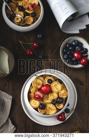 Trendy Homemade Breakfast, Pancake Cereal, Mini Pancakes With Berries, Top View