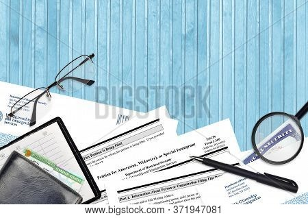Uscis Form I-360 Petition For Amerasian, Widower Or Special Immigrant Lies On Flat Lay Office Table
