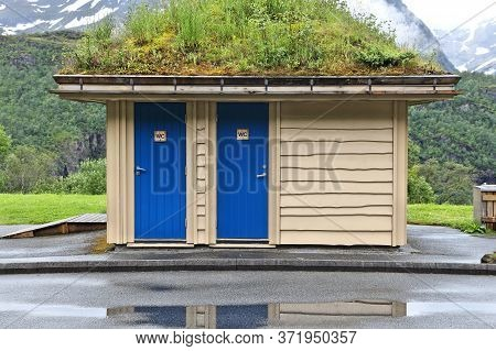 Tourist Restroom At A Rest Area Next To A Fiord In Nordland, Norway. Svartisen Area.