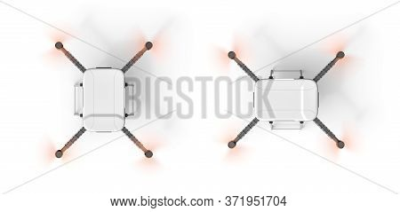 3d Rendering Of Top View Of Quadcopter With Working Propellers Isolated On White Background