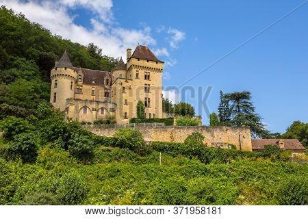 La Roque-Gageac, Dordogne, France - August 13, 2019: Chateau La Malartrie in La Roque-Gageac, Dordogne river valley. Aquitaine, France