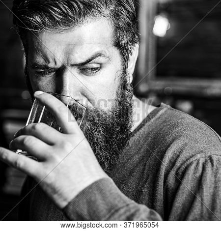 Portrait Of Handsome Young Man Holding Glass Of Cognac Whiskeyand Brandy. Elegant Man Holding A Glas