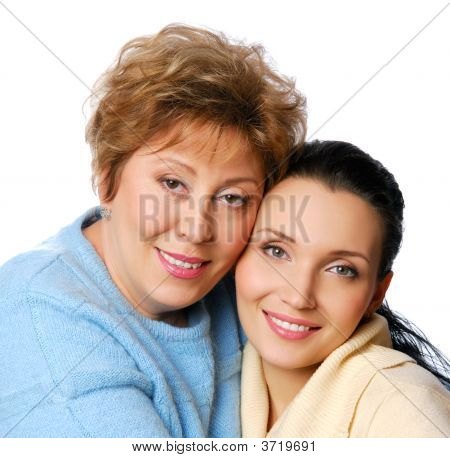 Two smiling woman embracing one another. Posing aty studio poster