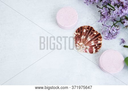 Concept Of Spa-cosmetic And Cosmetic Procedures. Bath Salt In Effervescent Tablets With Lilac Flower