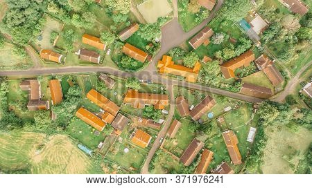 Aerial View Of A Small Village.top View Of Traditional Housing Estate In Czech. Looking Straight Dow