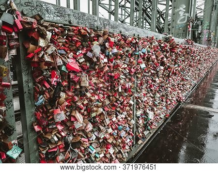 Cologne / Germany - 2018: Romantic Hohenzollern Bridge Full Of Padlocks That Symbolize Love And Fait