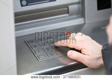 Closeup Male Hand Dials Pin Code On Terminal. Banking Equipment. Extent Of Atm Fraud. Secure Passwor