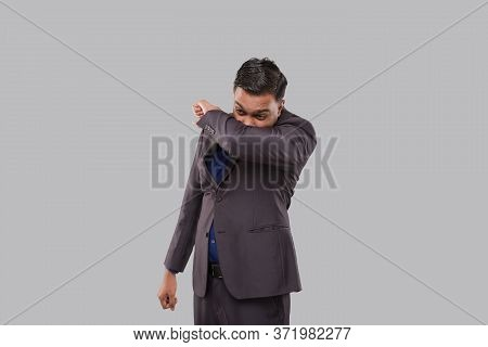 Businessman Sneezing Virus Style. Indian Business Man Sneezing In Elbow.