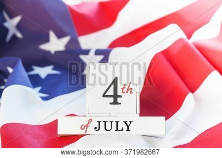 4th Of July Text On Us American Flag. Happy Independence Day. Stars And Stripes. Copy Space
