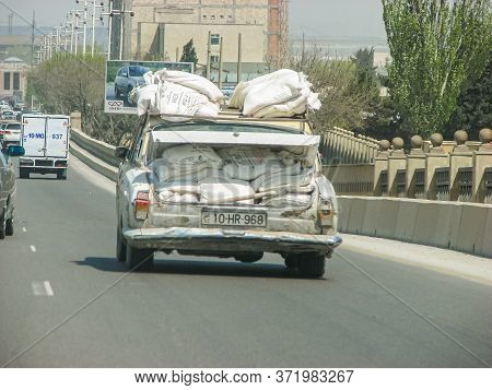 Azerbaijan, Baku - May 03, 2007: Classic Soviet Vintage Sedan Car Volga Gaz With Trunk That Is Overl