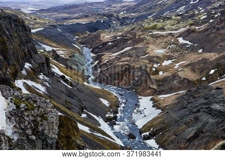 The Fossa River Flows In The Fossárdalur Valley In Iceland