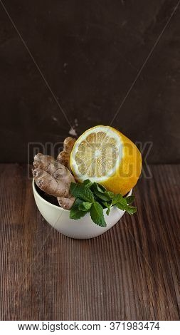 White Ceramic Bowl With Natural Healthy Flavours For Herbal Tea And Hot Dinks Half Of Lemon, Fresh M