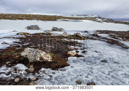 Snow And Ice Cover The Landscape Of The Valley In Iceland