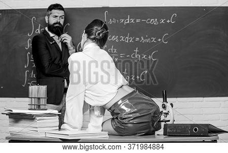 Standing Against Temptation. Tempting Teacher Or Student Rear View. Sensual Woman Seduce Bearded Man