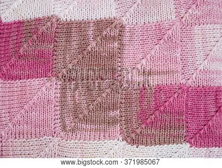 Knitted Background. Knitted Texture. A Sample Of Knitting. Knitting Pattern.