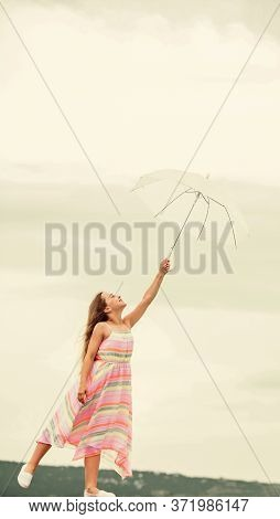 Girl With Light Umbrella. Anti Gravitation. Fly Drop Parachute. Dreaming About First Flight. Kid Pre