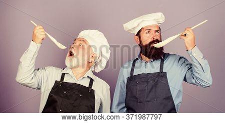 Only The Best. Chef Men Cooking. Cheerful Men Prepare Food. Professional Restaurant Cook. Taste Food