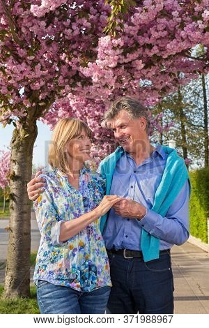 Affectionate Senior Couple Outdoors In Spring.