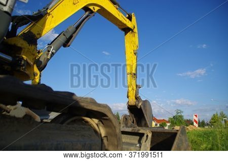 Excavator At A Construction Site. Digger Machine.