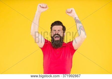 This Is Victory. Happy Hipster With Raised Hands Yellow Background. Bearded Man Celebrate Victory. G
