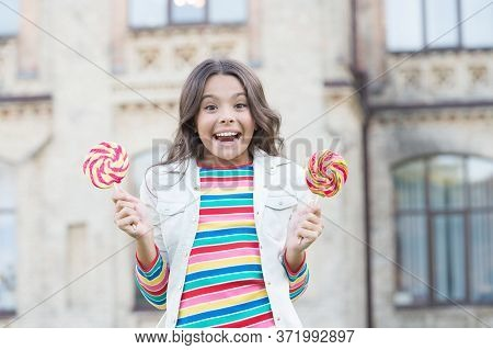 Childhood Happiness. Colorful And Sweet. Hipster Kid With Lollipop. Happy Childrens Day. Small Girl