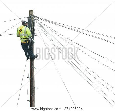 Isolated Lineman (or Lineworker Or Engineer) Fixing A Telephone Line