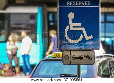 Bucharest, Romania - July 15, 2019: A Reserved Handicapped Parking Sign (reserved Disabled Parking S