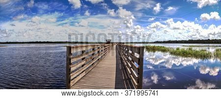 Boardwalk Overlooking The Flooded Swamp Of Myakka River State Park In Sarasota, Florida.