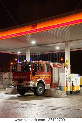 Kehl, Germany - Feb 17, 2020: Feuerwehr Firefighter Iveco Magirus Truck Loading Gas At Shell Gas Sta