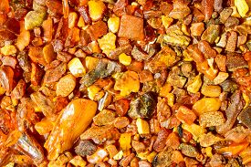 Close Up. Background, Texture.     Orange, Brown And Yellow Natural, Raw Amber Stones  Found On The