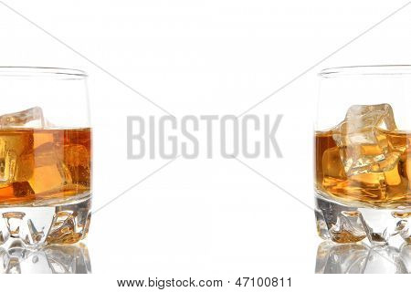 Brandy glasses with ice isolated on white