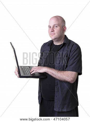 Middle aged bald man with laptop
