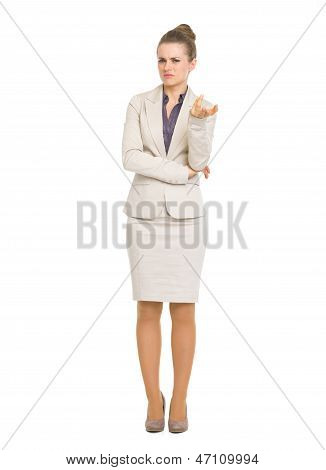 Full Length Portrait Of Concerned Business Woman