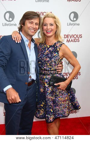 "LOS ANGELES - JUN 17:  Grant Shaw, Katherine LaNasa arrives at the ""Devious Maids""  Lifetime's Original Series Premiere at the Bel-Air Bay Club on June 17, 2013 in Pacific Palisades, CA"