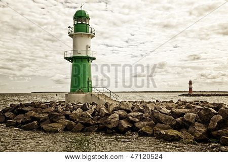 Green and red lighthouses at the harbor entrance of Rostock Warnemunde poster