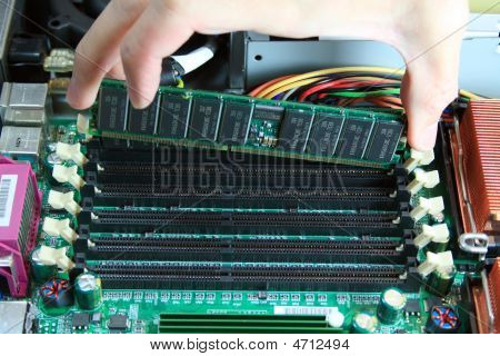 It Technician Installing Memory In A Server